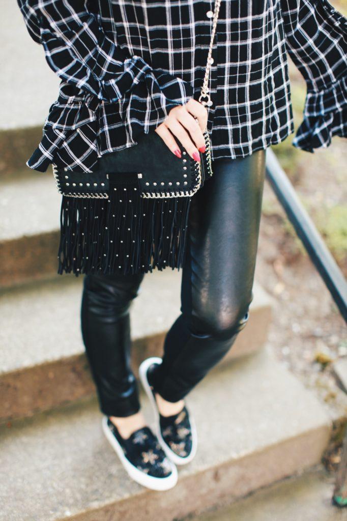 Leather leggings and fringe bag
